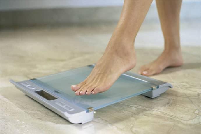 Лишний вес при жжении в пищеводе.